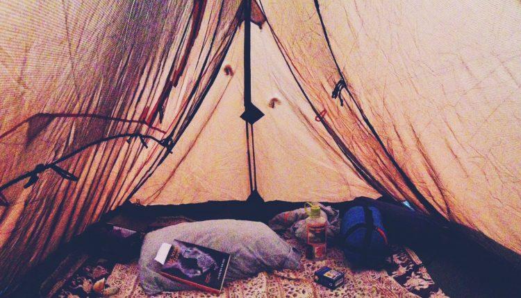 raining hippie tent den